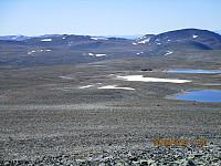 Utsikt ned mot Snøheim, og med Einøvlingseggen bak
