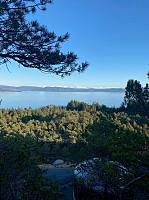 Utsikt fra Stordalsåsen, over vanntårnet og ut mot Bjørnafjorden. Folgefonn lengst bak.