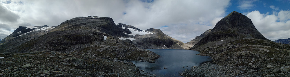 "Image #1: Lake Bispevatnet [i.e. ""The Bishop's Lake""] with Mount Finnan on the left side and Mount Bispen [i.e. ""The Bishop"" on the right side]. Partially hidden behind Mount Bispen, Mount Kongen [i.e. ""The King""] may be spotted. Far out to the left Mount Alnestind, which I visited three times on ski last winter, is seen."