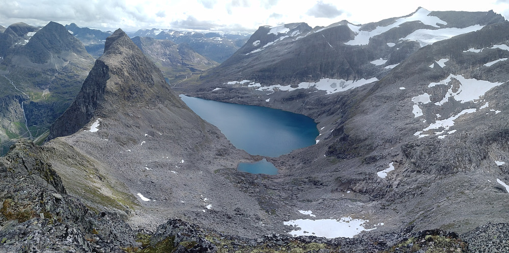 Image #16: Lake Bispevatnet as seen from the upper parts of Mount Kongen. To the left of the lake is seen Mount Bispen, to the right is Mount Finnan, and in the distance is seen Mount Alnestinden.