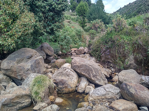 "#16: The little river that drains the entire Wochecha ""crater""."