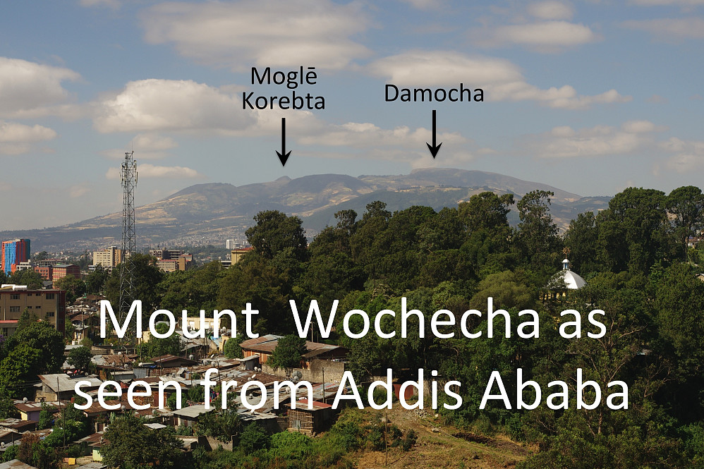 #23: It is possible to spot the highest Wochecha summits all the way from Addis Ababa. Moglē Korebta (3324 m.a.s.l.) and Damocha (3391 m.a.s.l.) are pointed out with arrows. Wochecha is the name of the entire mountain.