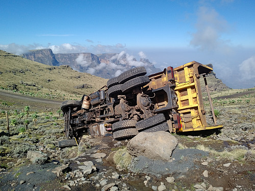 #12: An unfortunate vehicle that we encountered on our way from Chennek to Ras Bwahit. As a lorry owner I really felt sorry for this poor truck. The mountains in the background are (from left to right) Enatye, Shayno Sefer and Imet Gogo.