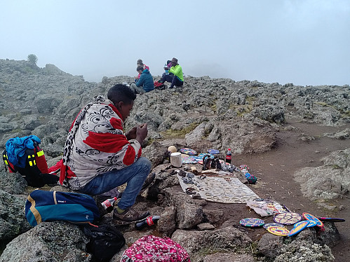 #15: A salesman selling Coke and souvenirs on the summit of Bwahit.