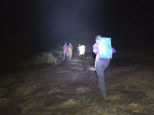 #22: Trekking up the Dashen mountain side in rain and fog guided by our headlamps.