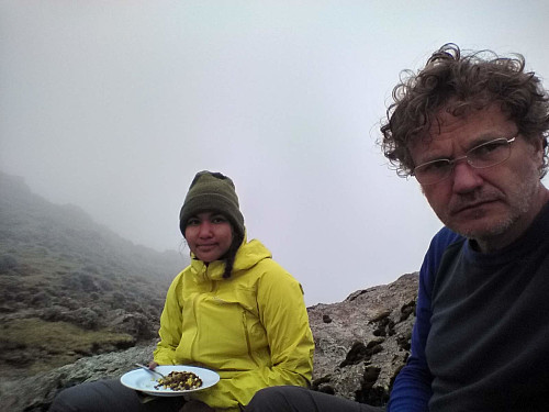 #55: Lunch time in the notch between Abba Yared and Mount Silki, at about 4150 m.a.m.s.l. I had a pair of glasses on, in order to have a look at our map.