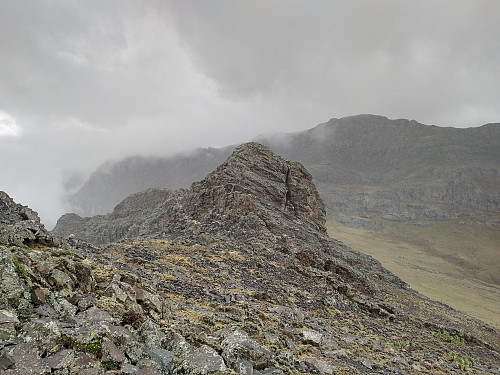 #57: The east peak of Mount Silki, as seen from the summit of the mountain. Mount Abba Yared is seen in the background.