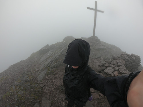 Soaked through, but finally at the top of Corrán Tuathail!