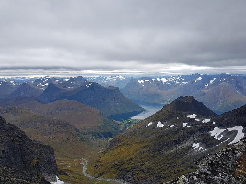Fra Midtre Regndalstind mot Urke og Hjørundfjorden. Mrk. Hurtigruta!