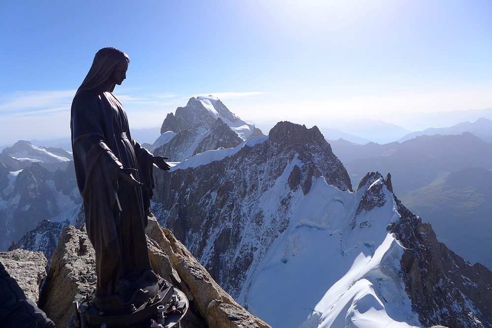 Madonna looking as calm as can be. Rochefort Arete and Grande Jorasses behind.