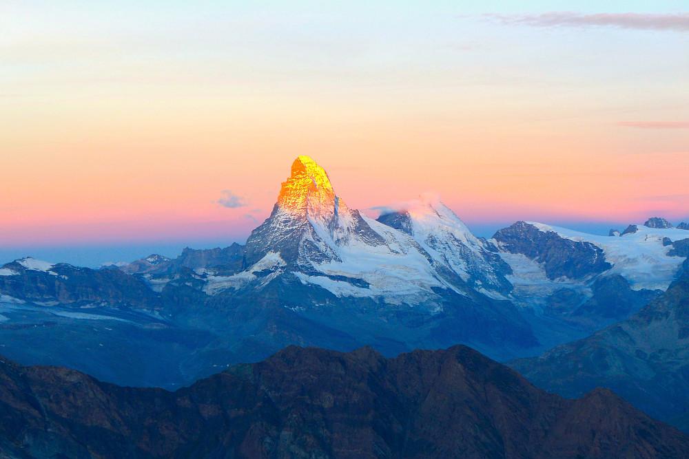First rays of sun on the Matterhorn