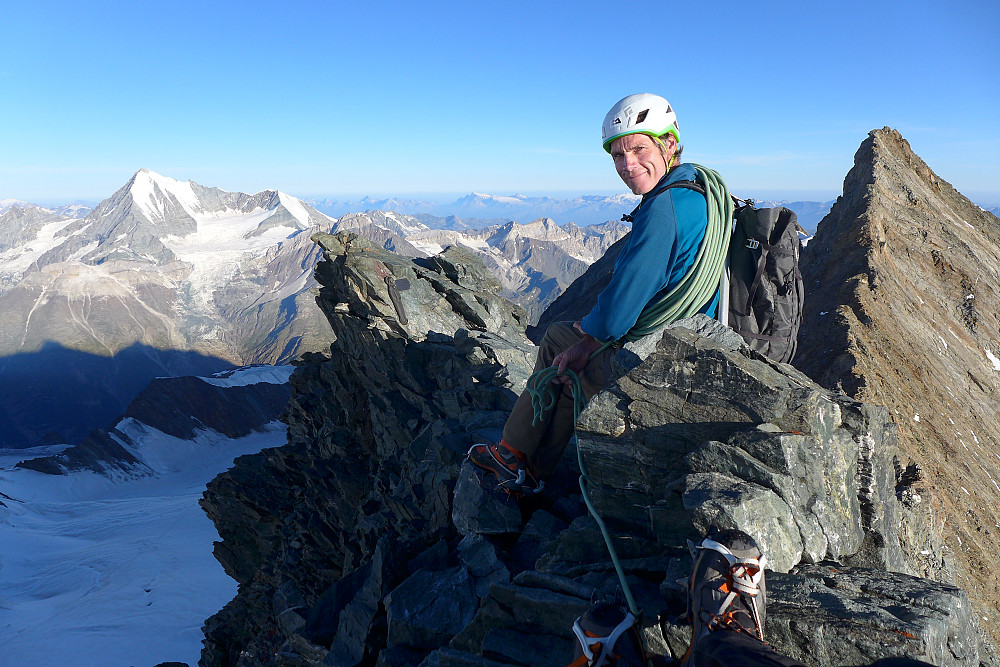 Tim at the summit of the Lenzspitze with the Nadelhorn to the right and Weisshorn on the left
