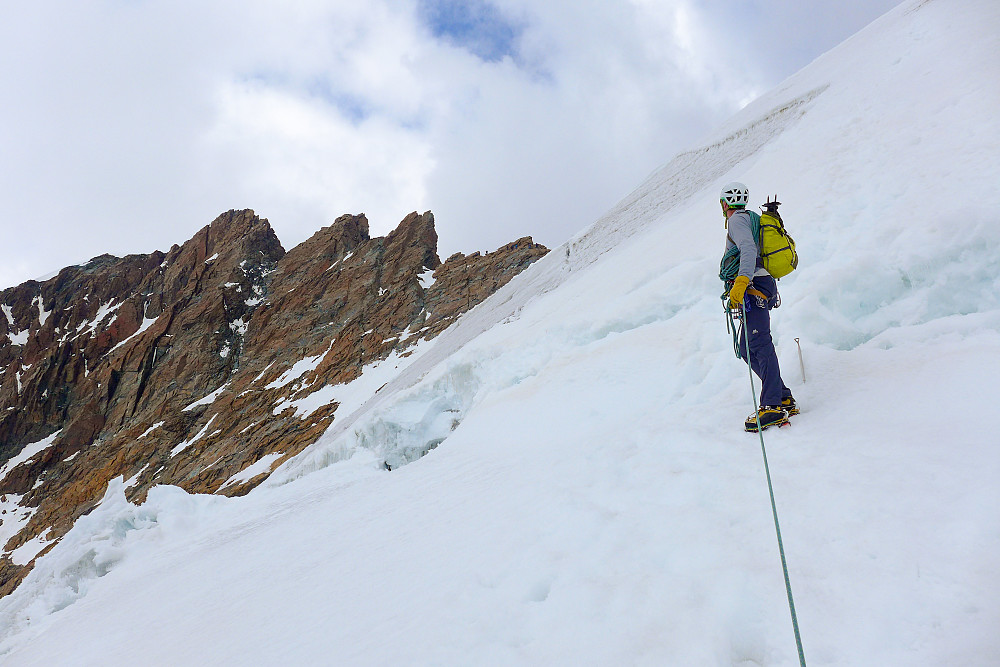Ascending the snow slopes up to the saddle between the eastern and western summits