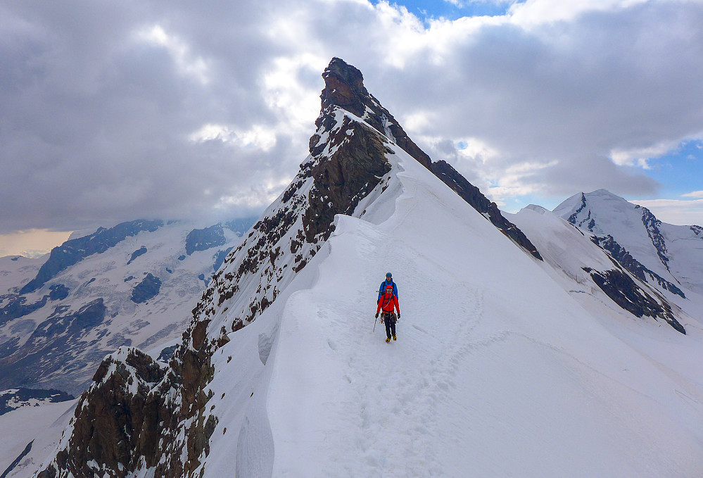 At the saddle with climbers having descended from the eastern summit