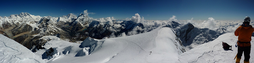 Summit panorama with Gordon standing at the right edge